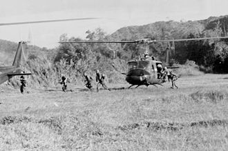 Robert Mason (writer) - Soldiers of 1st Battalion 7th Cavalry disembark from a UH-1 Huey at Landing Zone X-Ray during the Battle of Ia Drang