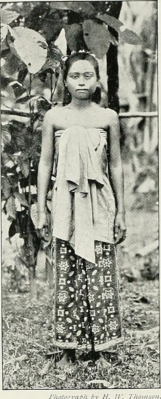 Kelantanese Malay people - A kain lepas draped about the breast (kain kemban) over a flowered sarong with decorative flowers in hair.
