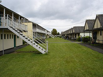 Holiday camp - This photograph of Butlins in Mosney shows the rows of chalet accommodation found at typical holiday camps until the 1980s.