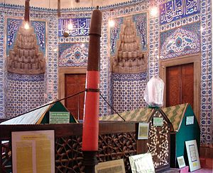 Türbe - The türbe of Hürrem Sultan (Roxelana) (d. 1558) at the Süleymaniye Mosque in Istanbul, showing tiling, draped sarcophagi, one empty turban pole, and one with a turban (protected by plastic wrapping)