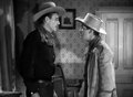 John Wayne and Russell Wade in Tall in the Saddle.png