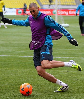 Adidas Finale - Karim Benzema of Real Madrid training with a high-visibility variant of the Finale in February 2012.