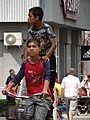 Kids on Bike - Berehove - Ukraine (36645903336) (2).jpg