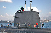 Sail of the French nuclear submarine Casabianca; note the diving planes, camouflaged masts, periscope, electronic warfare masts, door and windows.
