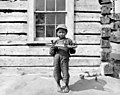 Kodiak Native American boy with skin boat model, Alaska, 1912 (AL+CA 6698).jpg