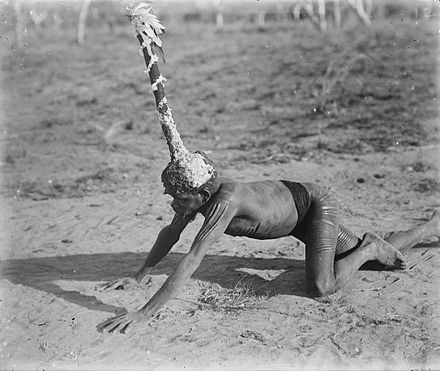 Kolaia man wearing a headdress worn in a fire ceremony, Forrest River, Western Australia. Aboriginal Australian religious practices associated with the Dreamtime have been practised for tens of thousands of years. Kolaia man.jpg