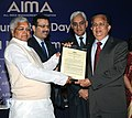 Lalu Prasad presenting the Public Service Excellence Award to Mr. G. Madhavan Nair, Chairman, ISRO & his Team, at the Foundation Day of All India Management Association (AIMA), in New Delhi on February 21, 2009.jpg