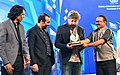 Laxmikant Parsekar presenting the Silver Peacock award for the Best Director to Mr. Baris Kaya and Mr. Soner Kaya for the film 'Rauf', at the closing ceremony of the 47th International Film Festival of India (IFFI-2016).jpg