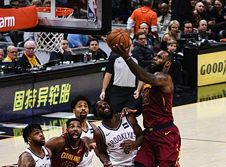 Basketball - LeBron James attempts a layup shot against the Brooklyn Nets