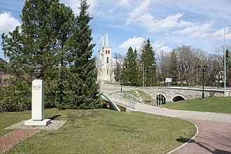 Rapla - Bridges over Vigala River. Rapla church in the background and monument to Brigadier General Märt Tiru on right