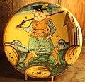 Maiolica di montelupo, piatto con figura, fucile e casa, 1620-40 ca..JPG