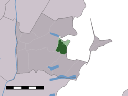 The town centre (dark green) and the statistical district (light green) of Monnickendam in the municipality of Waterland