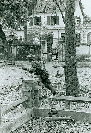 Marine Moves Out Under Enemy Fire, 3 February 1968 (15808129043).jpg