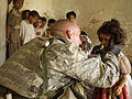 Medic Aids Iraqi Child DVIDS28488.jpg