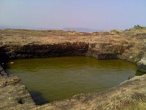 Cistern - Ancient Buddhist rock-hewn cistern at Pavurallakonda in India