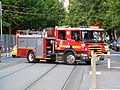 Melbourne fire truck across tram tracks.JPG