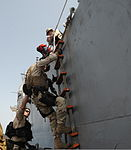 Members of the USS Anzio (CG 68) Visit, Board, Search and Seizure Team and U.S. Coast Guardsmen from Maritime Safety and Security Team 91104 climb down the side of Anzio Oct. 8, 2009, before boarding Yemeni 091008-N-PN943-008.jpg