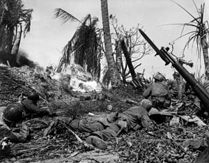 Battle of Kwajalein - Soldiers of the U.S. 7th Infantry Division attack a Japanese blockhouse on Kwajalein
