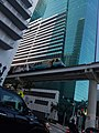 Metromover passes Wells Fargo Center building parking garage.jpg