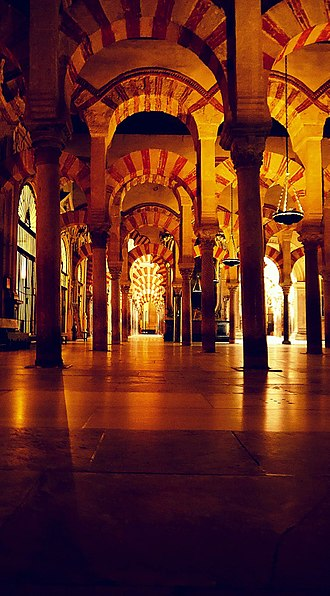 Al-Andalus - Interior of the Mosque–Cathedral of Córdoba formerly the Great Mosque of Córdoba. The original mosque (742), since much enlarged, was built on the site of the Visigothic Christian 'Saint Vincent basilica' (600).