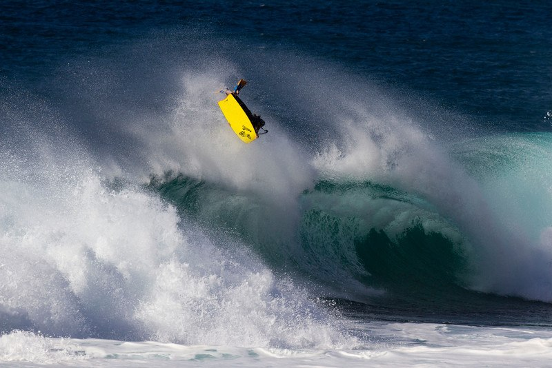 Michael Novy doing an air reverse 360 at Backdoor on the island of Oahu, Hawaii.