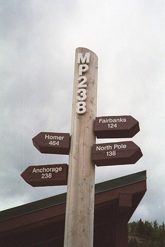 George Parks Highway - Milepost 238 signpost in McKinley Park.  The signpost is located in a turnout adjacent to a bridge crossing the Nenana River and near the entrance to Denali National Park.