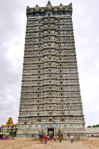 Murdeshwar - A HDR image of the 20-storied Gopura at the Murdeshwar temple. Two life-size elephants in concrete stand guard at the steps leading to it.