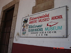 Basilica of Our Lady of Zapopan - Entrance signs for the Huichol Museum.