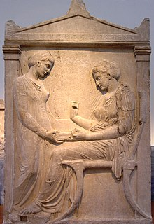 Photograph of a funeral stele, depicting a woman with her maidservant.