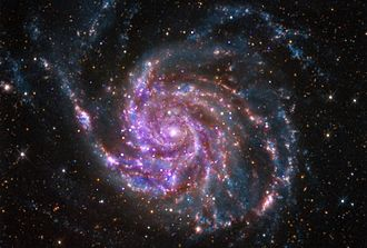 Pinwheel Galaxy - M101 - combined infrared, visible, and x-ray images.