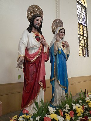 Novena - The statues of Jesus Christ and Virgin Mary at a church consecration.