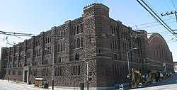 A view of the San Francisco Armory at the corner of Mission and 14th Streets
