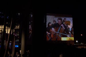 "New World Symphony (orchestra) - Members of the New World Symphony playing the Dvorak Cello Concerto, with soloist Johannes Moser as seen during a 2011 live outside ""wallcast"" at the New World Center"