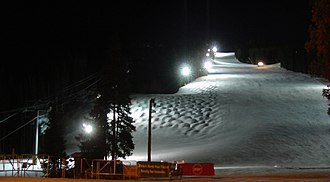 Night skiing - The River Run trail at Keystone Resort in Colorado lighted at night for night skiing