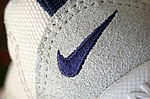 Nike swoosh on the tongue of a shoe (blue on white).jpg