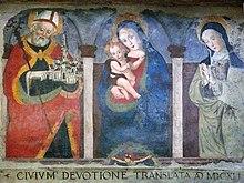 Norcia, Santa Maria Argentea: La Vergine con Bambino tra le rappresentazioni di san Benedetto da Norcia, con in mano un modello della città e di santa Scolastica (Francesco Sparapane, XVI secolo)
