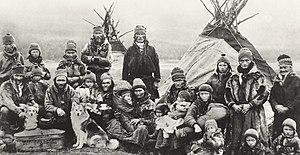Reindeer in Russia - Nomadic Sami people with reindeer skin tents and clothing in 1900-1920.