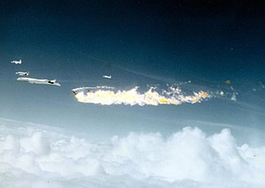 Mid-air collision - XB-70 Valkyrie 62-0207 following the mid-air collision on 8 June 1966. The XB-70 can be seen at the far left of the image, missing one of its vertical stabilisers, while the large fireball is the F-104 Starfighter it collided with.