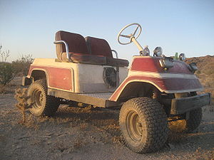 Golf cart - An off-road gasoline-powered golf cart.