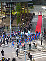 Olympic flame relay 2008 at Boulogne-Billancourt, in front of the Canal Plus building, with police escort.jpg