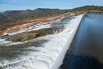 Oroville Dam - Water from the Oroville Dam flows over the emergency spillway on Sunday, February 12.