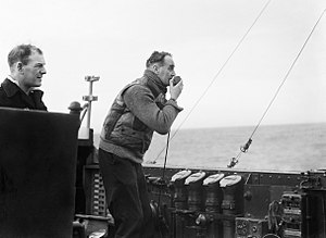Frederic John Walker - Walker using a loud hailer to encourage one of the ships under his command during an attack on a submarine in early 1944