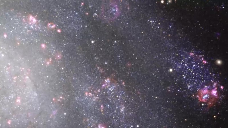 File:Panning across the southern spiral NGC 300 (ESO 1037a).webm