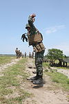 Philippine Marine Corps Sgt. Juan M. Rico, a rifleman, performs a squat thrust exercise while participating in a stress shoot event during Amphibious Landing Exercise (PHIBLEX) 14 at Naval Station Leovigildo 131006-M-CV548-013.jpg