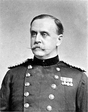 Black and white photograph of a man wiht a moustache in uniform.
