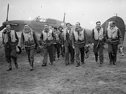 Polish 303 squadron pilots, 1940. Left to right: P/O Feric, Flt Lt Kent, F/O Grzeszczak, P/O Radomski, P/O Zumbach, P/O Lokuciewski, F/O Henneberg, Sgt. Rogowski, Sgt. Szaposznikow. Pilots of No. 303 (Polish) Squadron RAF with one of their Hawker Hurricanes, October 1940. CH1535.jpg