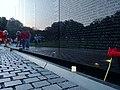 Placing a candle at Vietnam Memorial.jpg