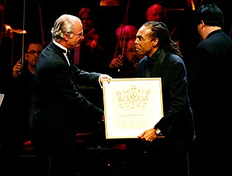 Polar Music Prize - Gilberto Gil - the winner in the contemporary category in 2005, receives the prize from King Carl XVI Gustaf of Sweden