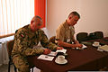 Polish Armed Forces (PAF) Col. Piotr Walega, left, a training and education chief with the Polish General Staff Training Directorate, and U.S. Marine Corps Col. Matt Baker, right, the commanding officer of 130521-M-AB423-003.jpg