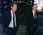 President Bush walks up the South Lawn towards the Oval Office with his son, George W. Bush.jpg